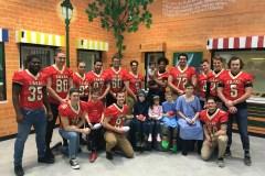Le Rouge et Or visite les enfants malades
